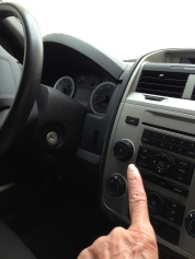 Finger Pointing to Car Radio