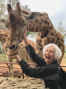 LG feeding giraffe